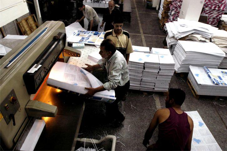 men-working-in-book-factory-725x482