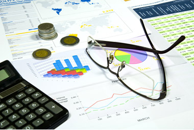 Calculator, glasses and money in finance analyzing